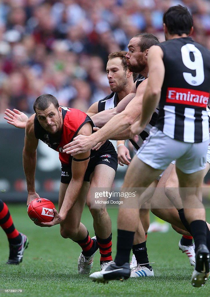 Scott Gumbleton of the Bombers handpasses the ball during the round five AFL match between the Essendon Bombers and the Collingwood Magpies at Melbourne Cricket Ground on April 25, 2013 in Melbourne, Australia.