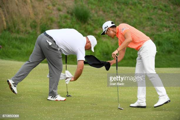 Scott Gutschewski and SJ Park wipe pollen off the eighth green during the first round of the Webcom Tour United Leasing Finance Championship at...