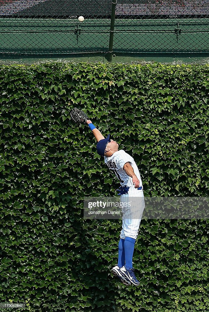 <a gi-track='captionPersonalityLinkClicked' href=/galleries/search?phrase=Scott+Hairston&family=editorial&specificpeople=836506 ng-click='$event.stopPropagation()'>Scott Hairston</a> #21 of the Chicago Cubs leaps in vain for a ball hit by Garrett Jones of the Pittsburgh Pirates in the 5th inning at Wrigley Field on July 5, 2013 in Chicago, Illinois.