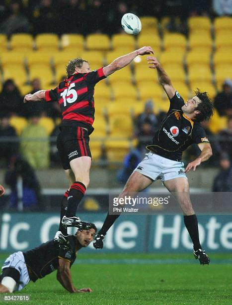 Scott Hamilton of Canterbury and Conrad Smith of Wellington leap for the ball during the Air New Zealand Cup Final match between the Wellington Lions...
