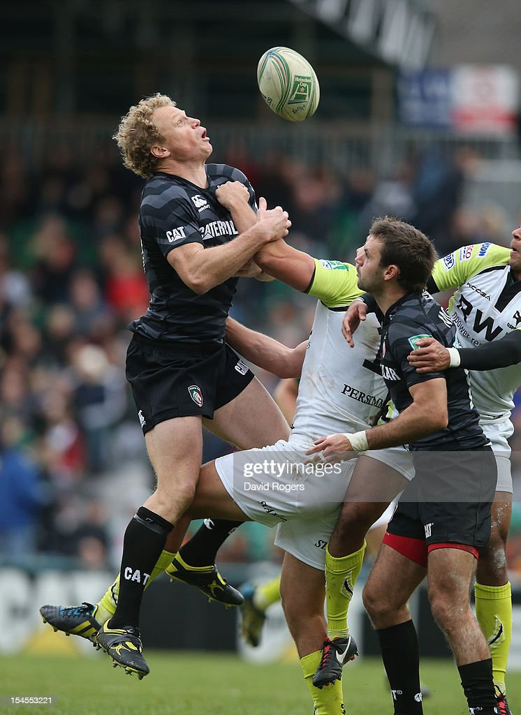 Scott Hamilton (L) of Leicester attempts to gather the high ball during the Heineken Cup match between Leicester Tigers and Ospreys at Welford Road on October 21, 2012 in Leicester, United Kingdom.