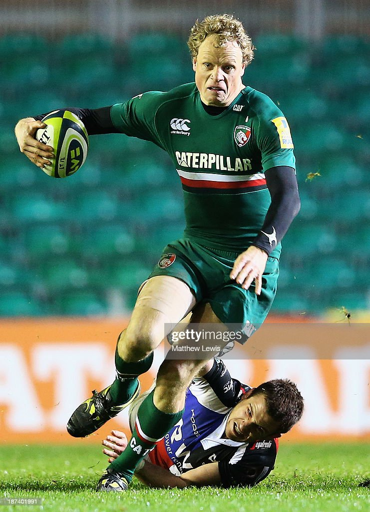 Scott Hamilton of the Leicester Tigers breaks through the tackle of Tom Grabham of the Ospreys during the LV=Cup match between Leicester Tigers and Ospreys at Welford Road on November 8, 2013 in Leicester, England.