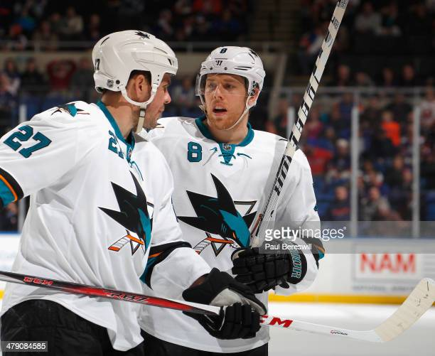 Scott Hannan and Joe Pavelski of the San Jose Sharks talk during an NHL hockey game against the New York Islanders at Nassau Veterans Memorial...