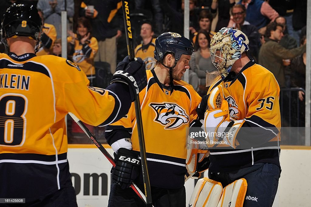 Scott Hannan #22 of the Nashville Predators congratulates teammate goalie Pekka Rinne #35 on defeating the Los Angeles Kings at the Bridgestone Arena on February 7, 2013 in Nashville, Tennessee.