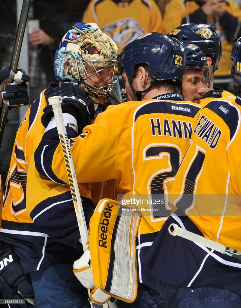 <a gi-track='captionPersonalityLinkClicked' href=/galleries/search?phrase=Scott+Hannan&family=editorial&specificpeople=203195 ng-click='$event.stopPropagation()'>Scott Hannan</a> #22 of the Nashville Predators congratulates teammate goalie <a gi-track='captionPersonalityLinkClicked' href=/galleries/search?phrase=Pekka+Rinne&family=editorial&specificpeople=2118342 ng-click='$event.stopPropagation()'>Pekka Rinne</a> #35 on defeating the Edmonton Oilers at Bridgestone Arena on March 8, 2013 in Nashville, Tennessee.