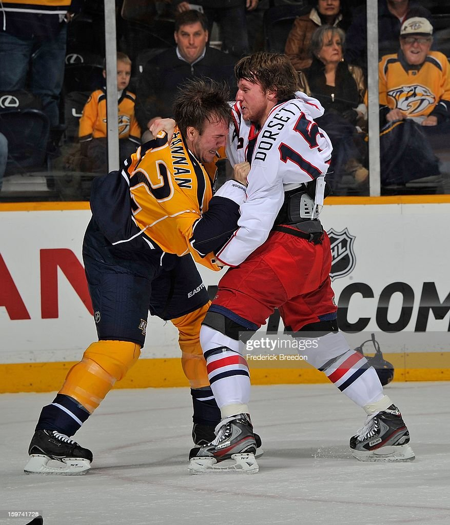 <a gi-track='captionPersonalityLinkClicked' href=/galleries/search?phrase=Scott+Hannan&family=editorial&specificpeople=203195 ng-click='$event.stopPropagation()'>Scott Hannan</a> #22 of the Nashville Predators fights <a gi-track='captionPersonalityLinkClicked' href=/galleries/search?phrase=Derek+Dorsett&family=editorial&specificpeople=4306277 ng-click='$event.stopPropagation()'>Derek Dorsett</a> #15 in their season opener at Bridgestone Arena on January 19, 2013 in Nashville, Tennessee.