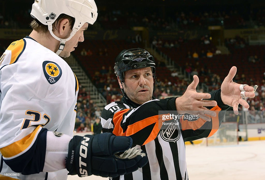 Scott Hannan #22 of the Nashville Predators questions a penalty call by referee Paul Devorski #10 at Jobing.com Arena on January 28, 2013 in Glendale, Arizona.