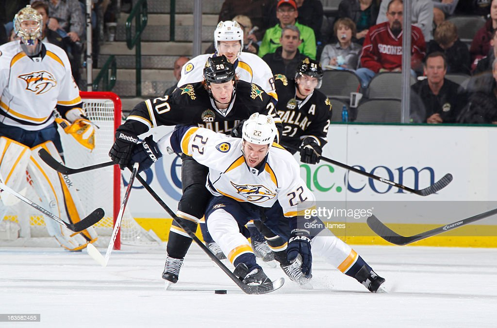 <a gi-track='captionPersonalityLinkClicked' href=/galleries/search?phrase=Scott+Hannan&family=editorial&specificpeople=203195 ng-click='$event.stopPropagation()'>Scott Hannan</a> #22 of the Nashville Predators tries to keep the puck away against <a gi-track='captionPersonalityLinkClicked' href=/galleries/search?phrase=Cody+Eakin&family=editorial&specificpeople=5662792 ng-click='$event.stopPropagation()'>Cody Eakin</a> #20 of the Dallas Stars at the American Airlines Center on March 12, 2013 in Dallas, Texas.