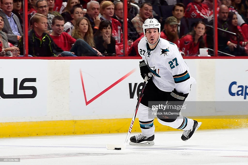 Scott Hannan #27 of the San Jose Sharks controls the puck in the third period during an NHL game against the Washington Capitals at Verizon Center on October 14, 2014 in Washington, DC.