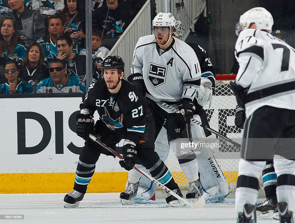 Scott Hannan #27 of the San Jose Sharks defends the net against Anze Kopitar #27 of the Los Angeles Kings in Game Four of the Western Conference Semifinals during the 2013 Stanley Cup Playoffs at HP Pavilion on May 21, 2013 in San Jose, California.