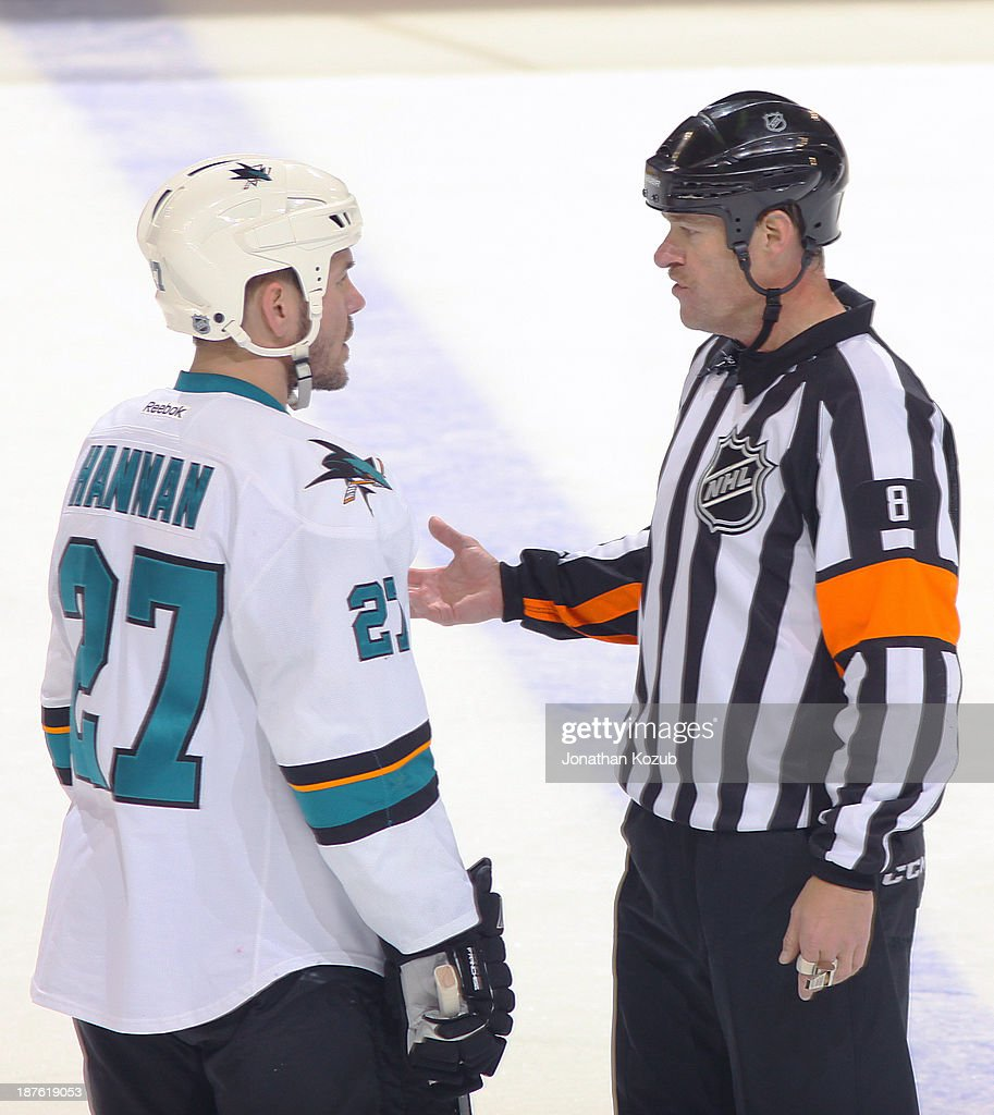 <a gi-track='captionPersonalityLinkClicked' href=/galleries/search?phrase=Scott+Hannan&family=editorial&specificpeople=203195 ng-click='$event.stopPropagation()'>Scott Hannan</a> #27 of the San Jose Sharks gets an explanation from referee Dave Jackson #8 during a second period stoppage in play against the Winnipeg Jets at the MTS Centre on November 10, 2013 in Winnipeg, Manitoba, Canada.