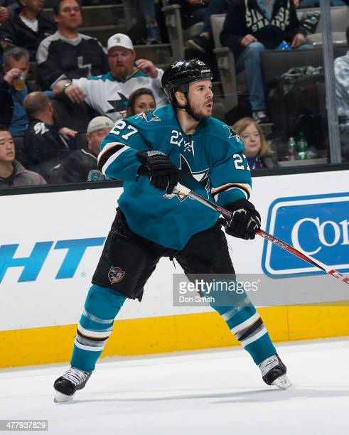 Scott Hannan of the San Jose Sharks passes the puck against the Carolina Hurricanes during an NHL game on March 4 2014 at SAP Center in San Jose...