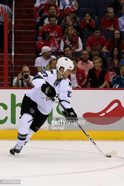 Scott Hannan of the San Jose Sharks passes the puck against the Washington Capitals at Verizon Center on October 14 2014 in Washington DC