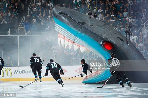 Scott Hannan of the San Jose Sharks skates out of the Shark's head during pregame introductions against the Los Angeles Kings in Game Five of the...