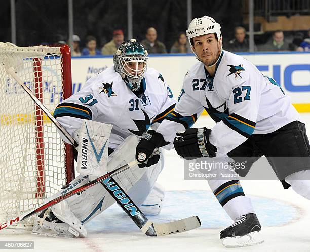 Scott Hannan skates in front of Antti Niemi of the San Jose Sharks during the second period against the New York Rangers on March 16 2014 at Madison...