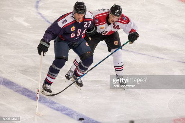 Scott Hannnan of Team USA and Adam Cracknell of Team Canada contest the puck during the Melbourne Game of the Ice Hockey Classic on June 24 2017 held...
