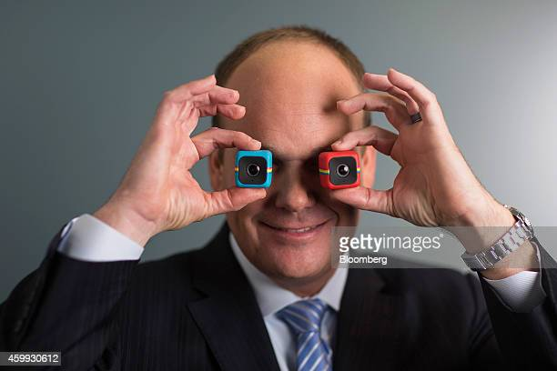 Scott Hardy chief executive officer of Polaroid holds the company's latest Cube digital cameras as he poses for a photograph following a Bloomberg...