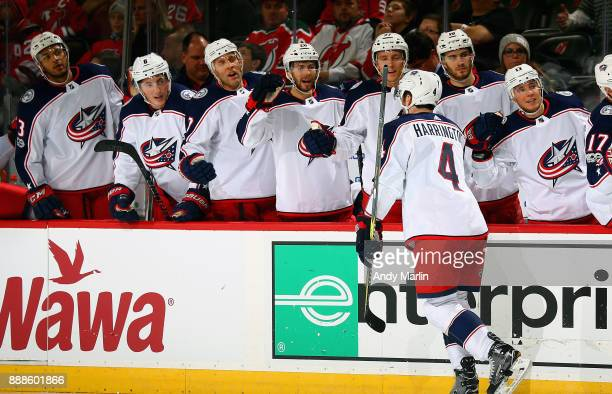 Scott Harrington of the Columbus Blue Jackets is congratulated by his teammates after scoring a secondperiod goal against the New Jersey Devils...