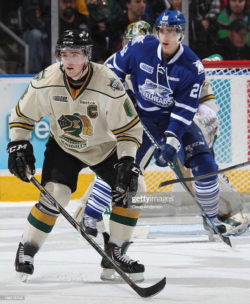Scott Harrington #6 of the London Knights defends in an OHL game against the Mississauga Steelheads on December 9, 2012 at the Budweiser Gardens in London, Ontario, Canada. The Knights defeated the Steelheads 5-2 and tied their franchise record of 18 straight wins.