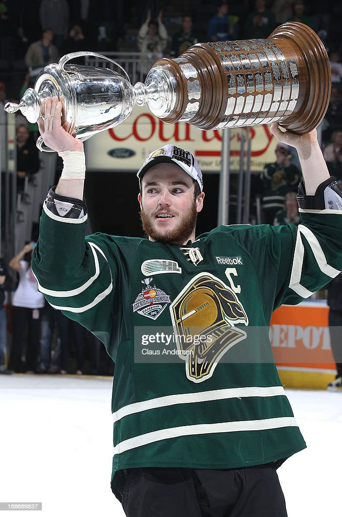 Scott Harrington #6 of the London Knights hoists the Robertson Cup after defeating the Barrie Colts in Game Seven of the 2013 OHL Championship Final on May 13, 2013 at the Budweiser Gardens in London, Ontario, Canada. The Knights defeated the Colts 3-2 to win the OHL Championship 4-3.