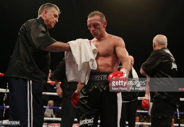 Scott Harrison appears dejected with his trainer Jimmy Tibbs following defeat to Liam Walsh during the WBO European Lightweight Championship fight at...