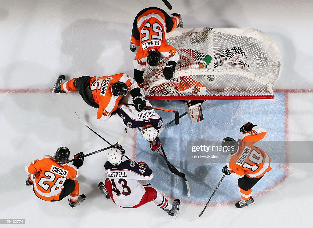 Scott Hartnell #43 and Nick Foligno #71 of the Columbus Blue Jackets battle in the crease of Steve Mason #43 of the Philadelphia Flyers with Nick Schultz #55, Braydon Coburn #5, Claude Giroux #28, and Brayden Schenn #10 on November 22, 2014 at the Wells Fargo Center in Philadelphia, Pennsylvania.