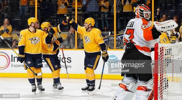 Scott Hartnell celebrates his goal with Matt Irwin and Yannick Weber of the Nashville Predators against Brian Elliott of the Philadelphia Flyers...