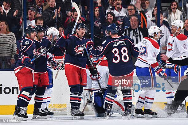 Scott Hartnell of the Columbus Blue Jackets celebrates his second period goal with teammates Brandon Dubinsky Brandon Saad and Boone Jenner of the...