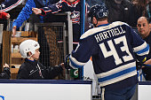 Scott Hartnell of the Columbus Blue Jackets fistbumps a fan after pregame warmups prior to a game against the Vancouver Canucks on November 28 2014...
