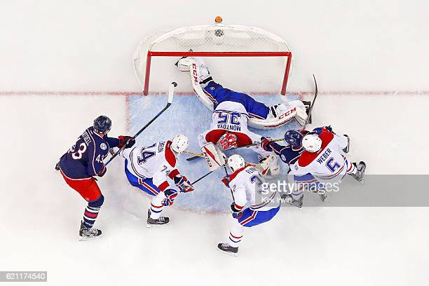 Scott Hartnell of the Columbus Blue Jackets flips the puck past Al Montoya of the Montreal Canadiens for a goal during the second period on November...
