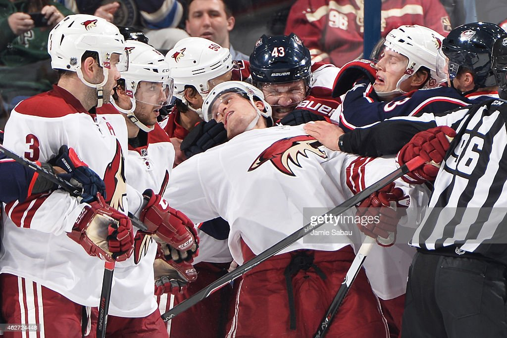 Scott Hartnell of the Columbus Blue Jackets grabs Michael Stone of the Arizona Coyotes during the second period on February 3 2015 at Nationwide...