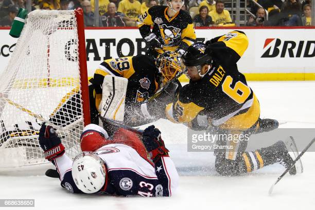 Scott Hartnell of the Columbus Blue Jackets is checked by Trevor Daley of the Pittsburgh Penguins while trying to get off a first period shot in Game...