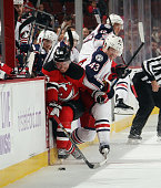 Scott Hartnell of the Columbus Blue Jackets squeezes Jacob Josefson of the New Jersey Devils into the boards during the second period at the...
