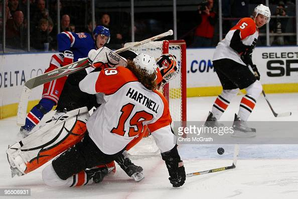 Scott Hartnell of the Philadelphia Flyers and goal keeper Michael Leighton defend a shot at goal against the New York Rangers during their game on...