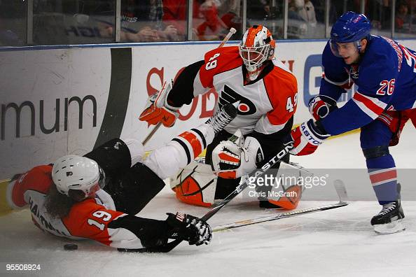 Scott Hartnell of the Philadelphia Flyers and goal keeper Michael Leighton defend against Erik Christensen of the New York Rangers during their game...