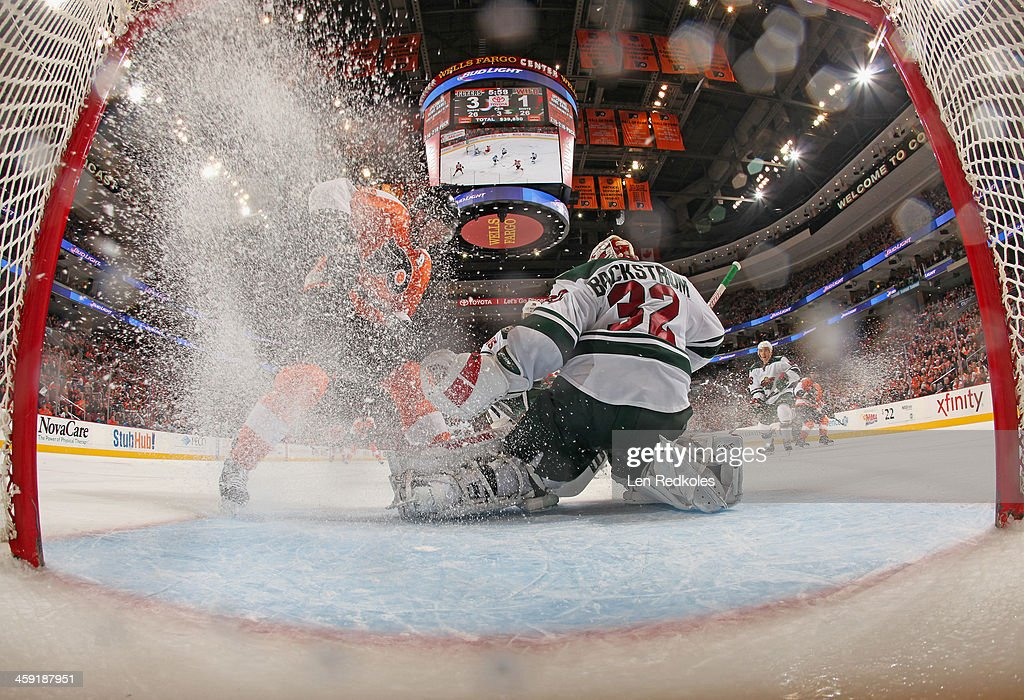 <a gi-track='captionPersonalityLinkClicked' href=/galleries/search?phrase=Scott+Hartnell&family=editorial&specificpeople=201889 ng-click='$event.stopPropagation()'>Scott Hartnell</a> #19 of the Philadelphia Flyers attempts a scoring chance against Niklas Backstrom #32 of the Minnesota Wild on December 23, 2013 at the Wells Fargo Center in Philadelphia, Pennsylvania. The Flyers defeated the Wild 4-1.