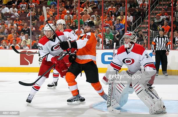 Scott Hartnell of the Philadelphia Flyers battles in the crease against Brett Bellemore Riley Nash and Anton Khudobin of the Carolina Hurricanes on...
