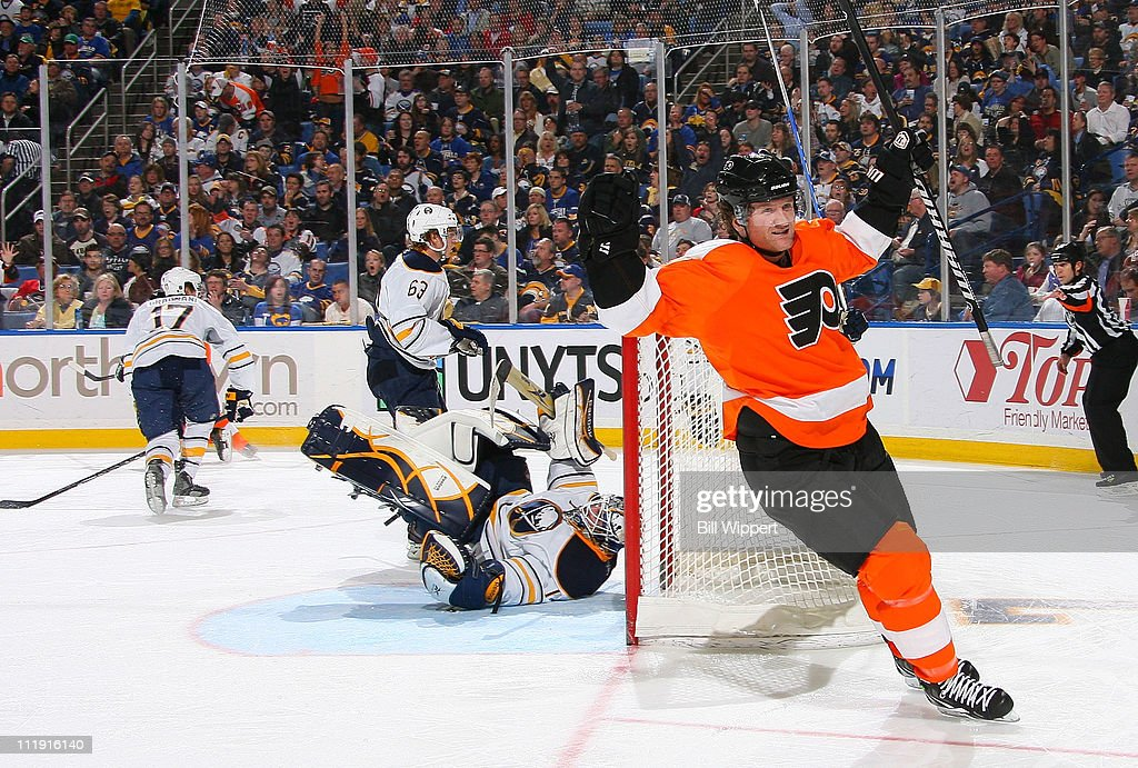 <a gi-track='captionPersonalityLinkClicked' href=/galleries/search?phrase=Scott+Hartnell&family=editorial&specificpeople=201889 ng-click='$event.stopPropagation()'>Scott Hartnell</a> #19 of the Philadelphia Flyers celebrates a goal by teammate Danny Brier (not shown) against goaltender <a gi-track='captionPersonalityLinkClicked' href=/galleries/search?phrase=Jhonas+Enroth&family=editorial&specificpeople=570456 ng-click='$event.stopPropagation()'>Jhonas Enroth</a> #1 of the Buffalo Sabres at HSBC Arena on March 8, 2011 in Buffalo, New York.
