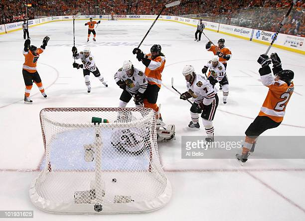 Scott Hartnell of the Philadelphia Flyers celebrates after scoring a power play goal in the first period against Antti Niemi of the Chicago...