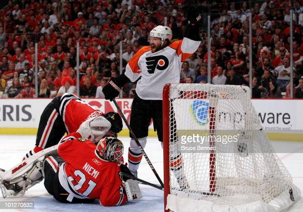 Scott Hartnell of the Philadelphia Flyers celebrates after the goal of teammate Ville Leino against Antti Niemi of the Chicago Blackhawks in Game One...