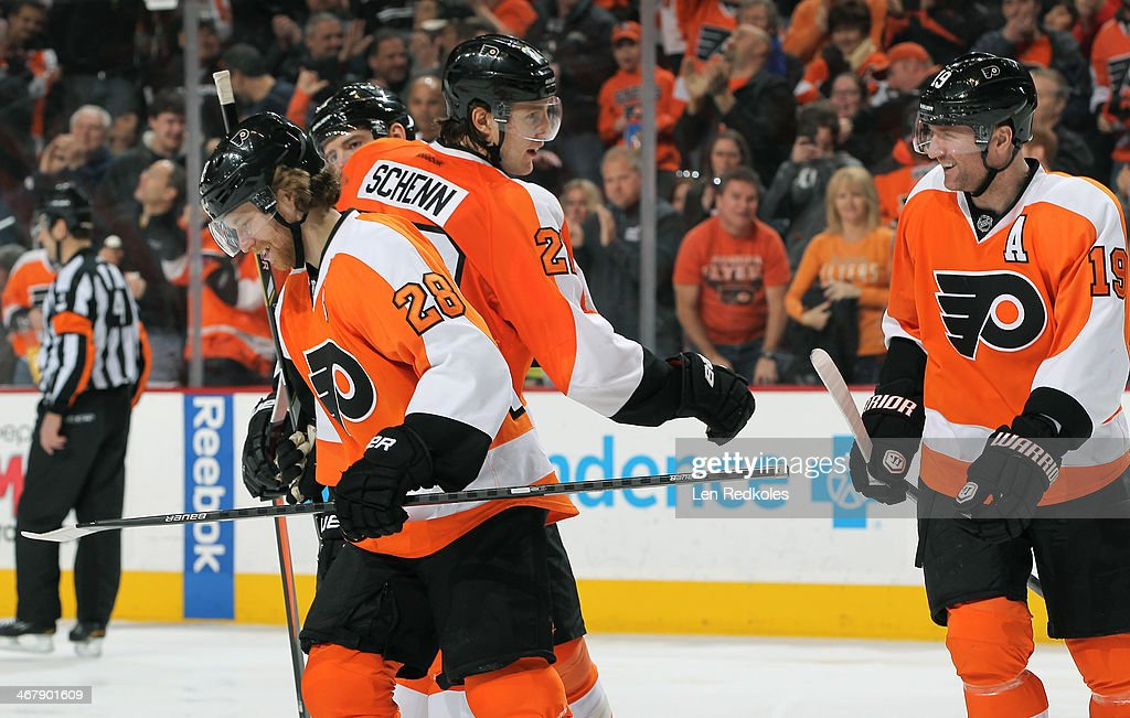 <a gi-track='captionPersonalityLinkClicked' href=/galleries/search?phrase=Scott+Hartnell&family=editorial&specificpeople=201889 ng-click='$event.stopPropagation()'>Scott Hartnell</a> #19 of the Philadelphia Flyers celebrates his game winning goal with teammates <a gi-track='captionPersonalityLinkClicked' href=/galleries/search?phrase=Luke+Schenn&family=editorial&specificpeople=4254202 ng-click='$event.stopPropagation()'>Luke Schenn</a> #22 and <a gi-track='captionPersonalityLinkClicked' href=/galleries/search?phrase=Claude+Giroux&family=editorial&specificpeople=537961 ng-click='$event.stopPropagation()'>Claude Giroux</a> #28 against the Calgary Flames on February 8, 2014 at the Wells Fargo Center in Philadelphia, Pennsylvania. The Flyers defeated the Flames 2-1.