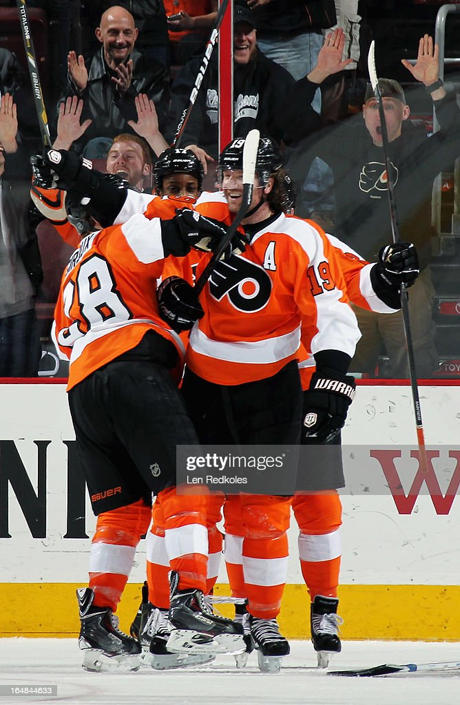 <a gi-track='captionPersonalityLinkClicked' href=/galleries/search?phrase=Scott+Hartnell&family=editorial&specificpeople=201889 ng-click='$event.stopPropagation()'>Scott Hartnell</a> #19 of the Philadelphia Flyers celebrates his game-tying power-play goal against the New York Islanders in the third period with teammates <a gi-track='captionPersonalityLinkClicked' href=/galleries/search?phrase=Claude+Giroux&family=editorial&specificpeople=537961 ng-click='$event.stopPropagation()'>Claude Giroux</a> #28 and <a gi-track='captionPersonalityLinkClicked' href=/galleries/search?phrase=Wayne+Simmonds&family=editorial&specificpeople=4212617 ng-click='$event.stopPropagation()'>Wayne Simmonds</a> #17 on March 28, 2013 at the Wells Fargo Center in Philadelphia, Pennsylvania. The Islanders defeated the Flyers 4-3 in a shootout.