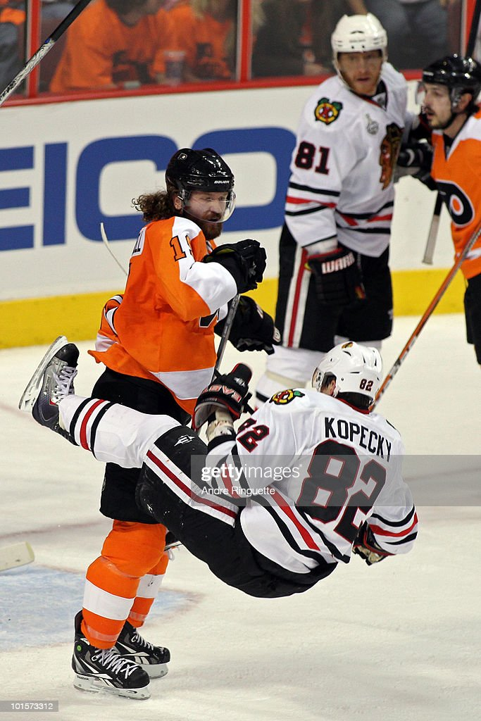 Scott Hartnell of the Philadelphia Flyers checks Tomas Kopecky of the Chicago Blackhawks in Game Three of the 2010 NHL Stanley Cup Final at Wachovia...