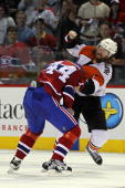Scott Hartnell of the Philadelphia Flyers fights against Roman Hamrlik of the Montreal Canadiens in Game 3 of the Eastern Conference Finals during...