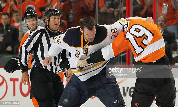 Scott Hartnell of the Philadelphia Flyers fights Paul Gaustad of the Buffalo Sabres in the first period in Game Two of the Eastern Conference...