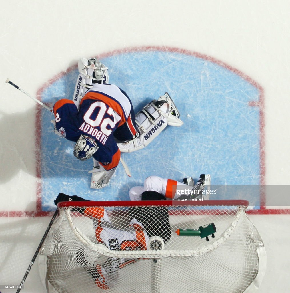 <a gi-track='captionPersonalityLinkClicked' href=/galleries/search?phrase=Scott+Hartnell&family=editorial&specificpeople=201889 ng-click='$event.stopPropagation()'>Scott Hartnell</a> #19 of the Philadelphia Flyers flies past <a gi-track='captionPersonalityLinkClicked' href=/galleries/search?phrase=Evgeni+Nabokov&family=editorial&specificpeople=171380 ng-click='$event.stopPropagation()'>Evgeni Nabokov</a> #20 of the New York Islanders and into the net at the Nassau Veterans Memorial Coliseum on March 15, 2012 in Uniondale, New York. The Flyers defeated the Islanders 3-2.