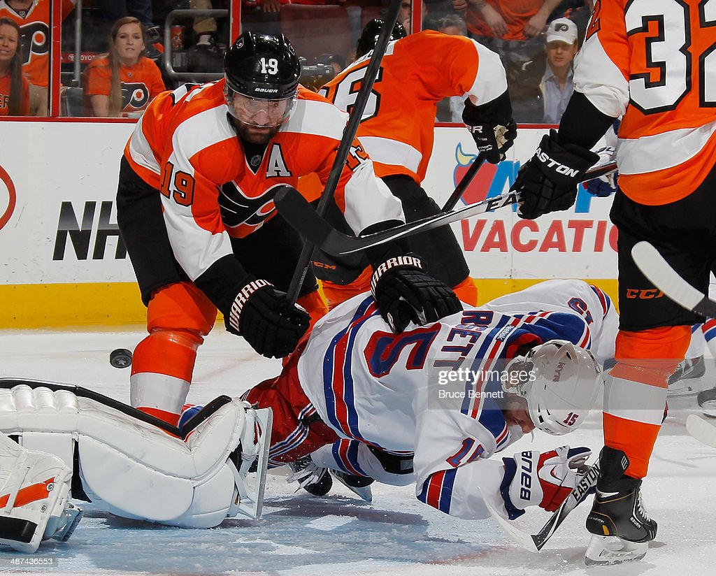 <a gi-track='captionPersonalityLinkClicked' href=/galleries/search?phrase=Scott+Hartnell&family=editorial&specificpeople=201889 ng-click='$event.stopPropagation()'>Scott Hartnell</a> #19 of the Philadelphia Flyers hits <a gi-track='captionPersonalityLinkClicked' href=/galleries/search?phrase=Derek+Dorsett&family=editorial&specificpeople=4306277 ng-click='$event.stopPropagation()'>Derek Dorsett</a> #15 of the New York Rangers in Game Six of the First Round of the 2014 NHL Stanley Cup Playoffs at the Wells Fargo Center on April 29, 2014 in Philadelphia, Pennsylvania. The Flyers defeated the Rangers 5-2.