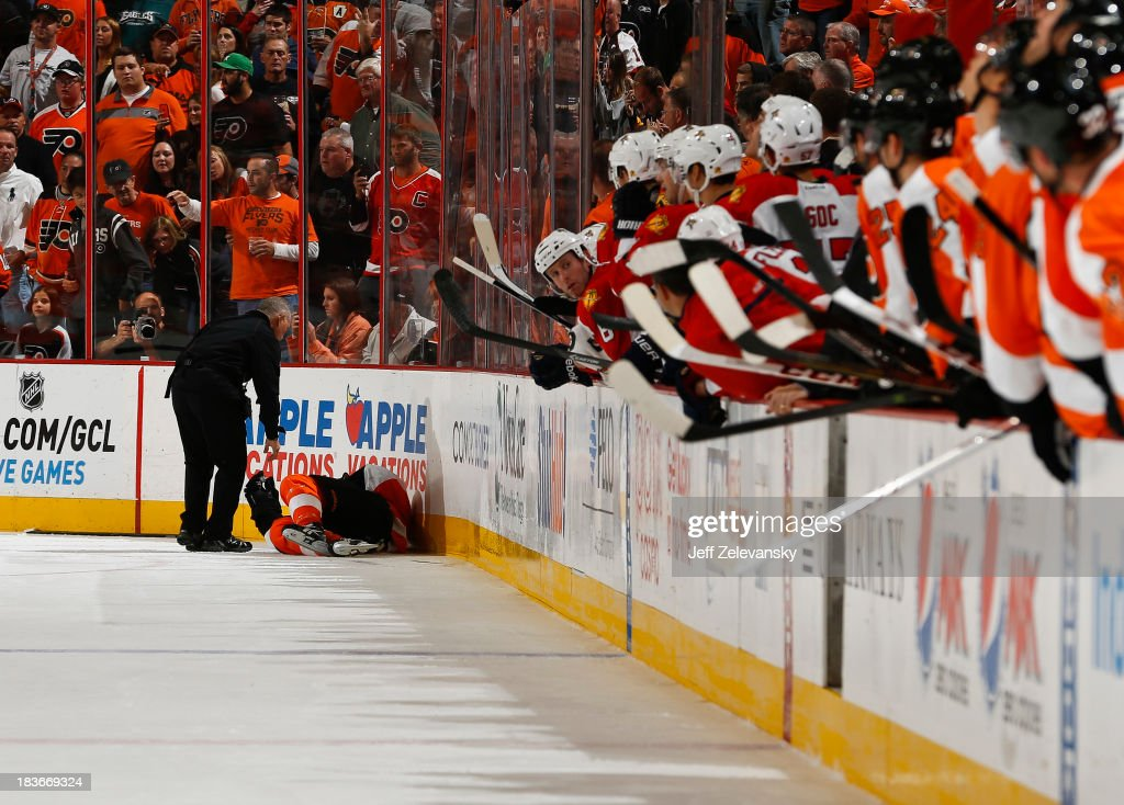 <a gi-track='captionPersonalityLinkClicked' href=/galleries/search?phrase=Scott+Hartnell&family=editorial&specificpeople=201889 ng-click='$event.stopPropagation()'>Scott Hartnell</a> #19 of the Philadelphia Flyers lies on the ice after a hard hit against the Florida Panthers at the Wells Fargo Center on October 8, 2013 in Philadelphia, Pennsylvania.