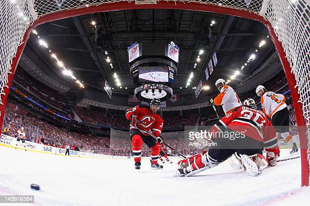 Scott Hartnell of the Philadelphia Flyers scores a power play goal against Martin Brodeur of the New Jersey Devils in Game Four of the Eastern...