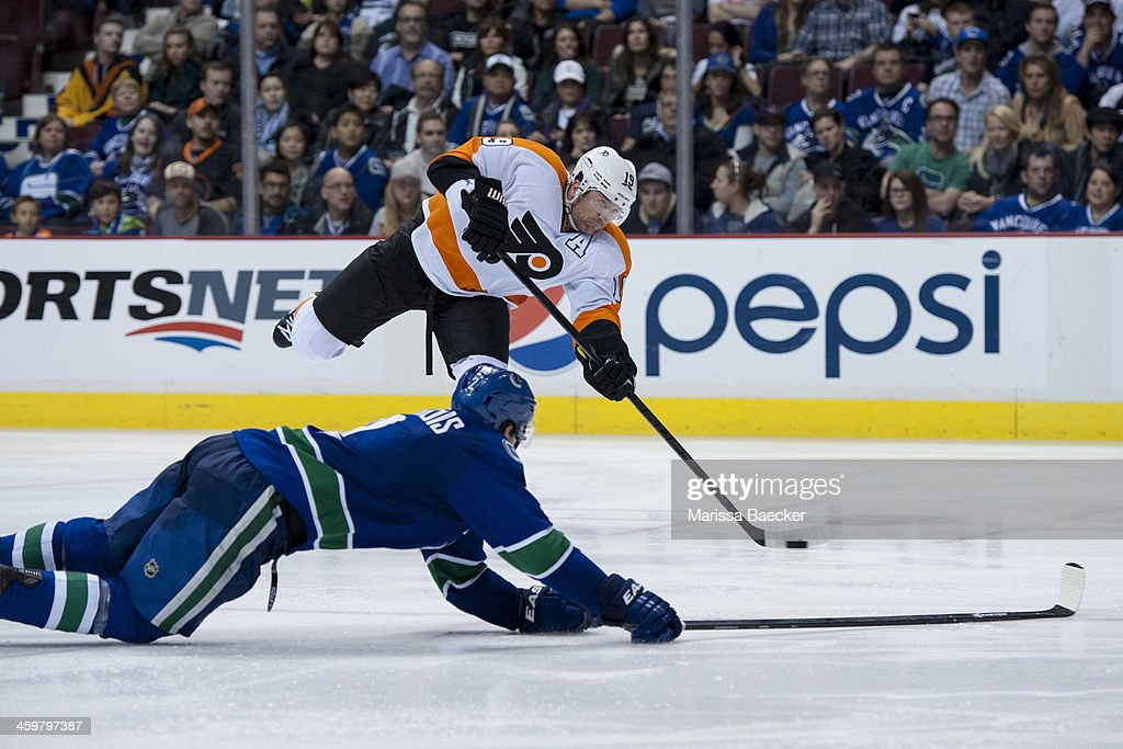<a gi-track='captionPersonalityLinkClicked' href=/galleries/search?phrase=Scott+Hartnell&family=editorial&specificpeople=201889 ng-click='$event.stopPropagation()'>Scott Hartnell</a> #19 of the Philadelphia Flyers takes a shot as Dan Hamhuis #2 of the Vancouver Canucks tries to block on December 30, 2013 at Rogers Arena in Vancouver, British Columbia, Canada.